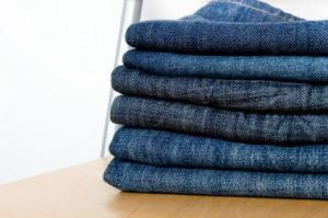 stack of identical blue jeans