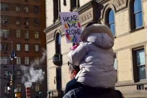 girl holds political poster