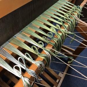 Handwoven Green Fabric - beginning knots