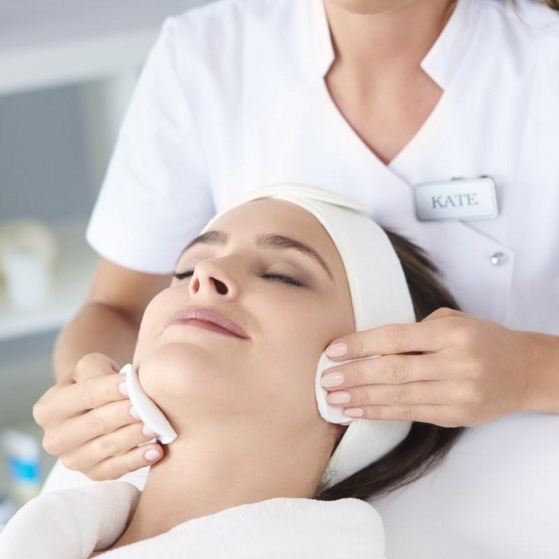 Beautiful woman doing facial her client