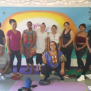 a group of happy relaxed folks after a slow down Sunday class
