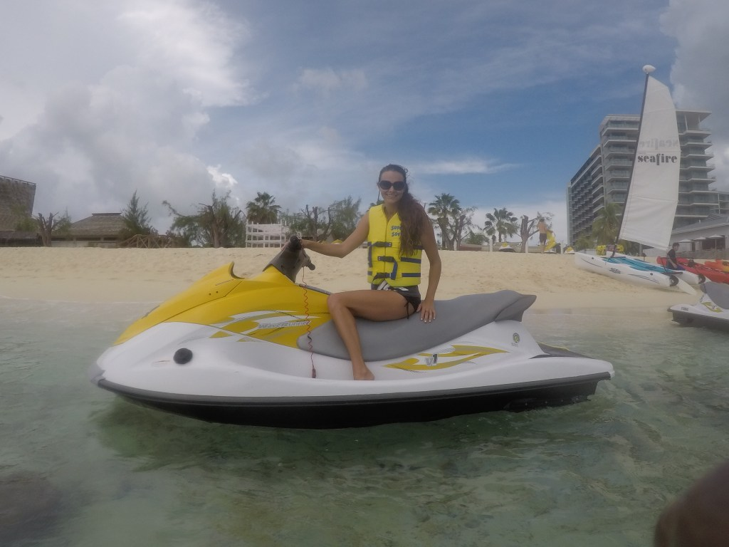 Jet ski in The Cayman Islands | Caribbean vacation | THings to do in the CAymans | Mandy Carter travel writer | Florida travel blog | cayman vacation | Acupful.com family travel blogger | 7 mile beach snorkel | Red Sail Sports | Swim with Stingrays | Starfish Point | Seafire Resort & Spa | Kimpton Hotels Grand Cayman