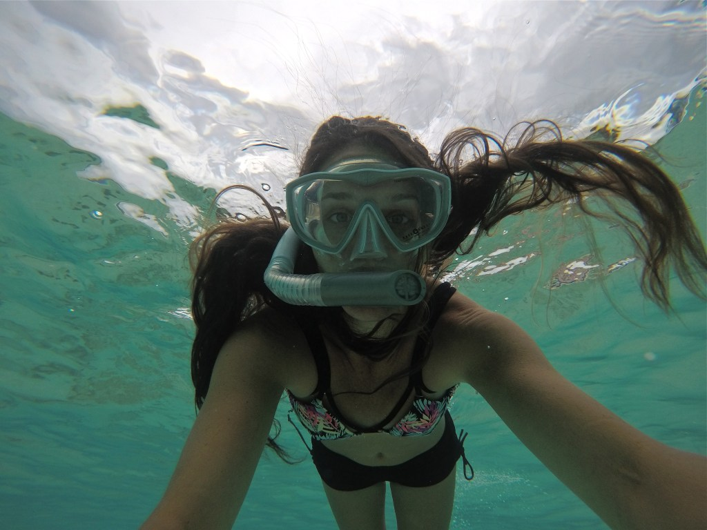 Snorkeling in The Cayman Islands | Caribbean vacation | THings to do in the CAymans | Mandy Carter travel writer | Florida travel blog | cayman vacation | Acupful.com family travel blogger | 7 mile beach snorkel | Red Sail Sports