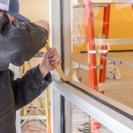 Eric Installing Vinyl Seal - Commercial Glass Storefront Installation Service