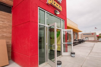 Close-up of Peter Piper Pizza Commercial Storefront Entryway Glass