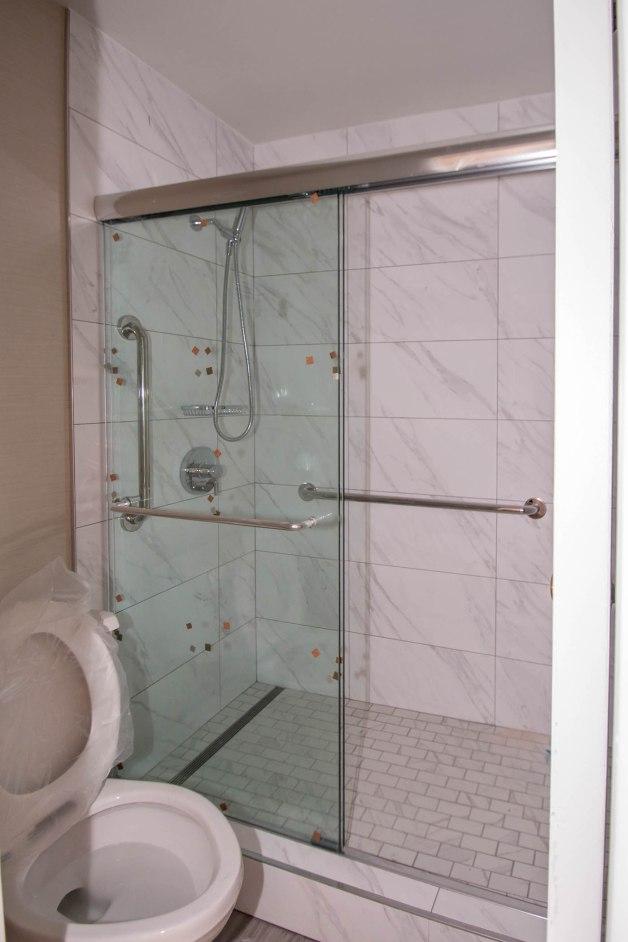Close-Up of California Hotel Custom Shower Door Enclosure Installation