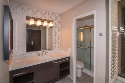 Custom Glass Shower Door Enclosure System by A Cutting Edge Glass & Mirror - California Hotel