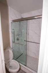 Hotel California - Close-Up of Glass Shower Door Enclosure System