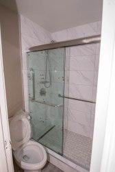 Hotel California - Close-Up of Glass Shower Door Enclosure System