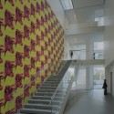 AD Classics: The Museum of Modern Art Staircase to 2nd floor with Andy Warhol's Cow wallpaper in the Education and Research Building. Image © Timothy Hursley