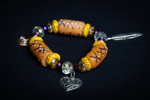 Clear, Purple and Tan and Yellow/Red Beads with Heart (Crown) Charm