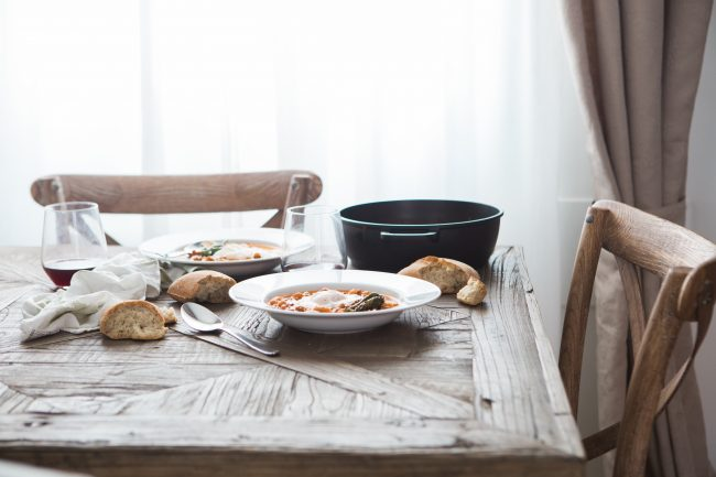 A tasty meal with friends and family is a good way to invite Hygge into your home.