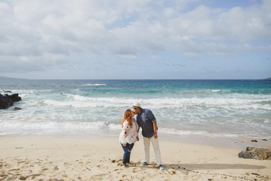 Interracial couple kissing on Oneloa Beach, Maui