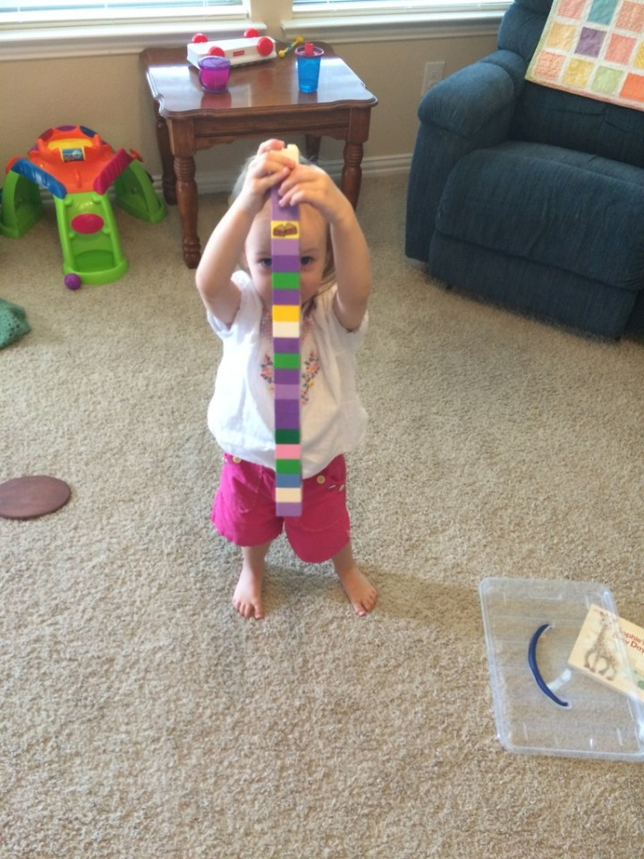 Eliza made this Lego tower all by herself.