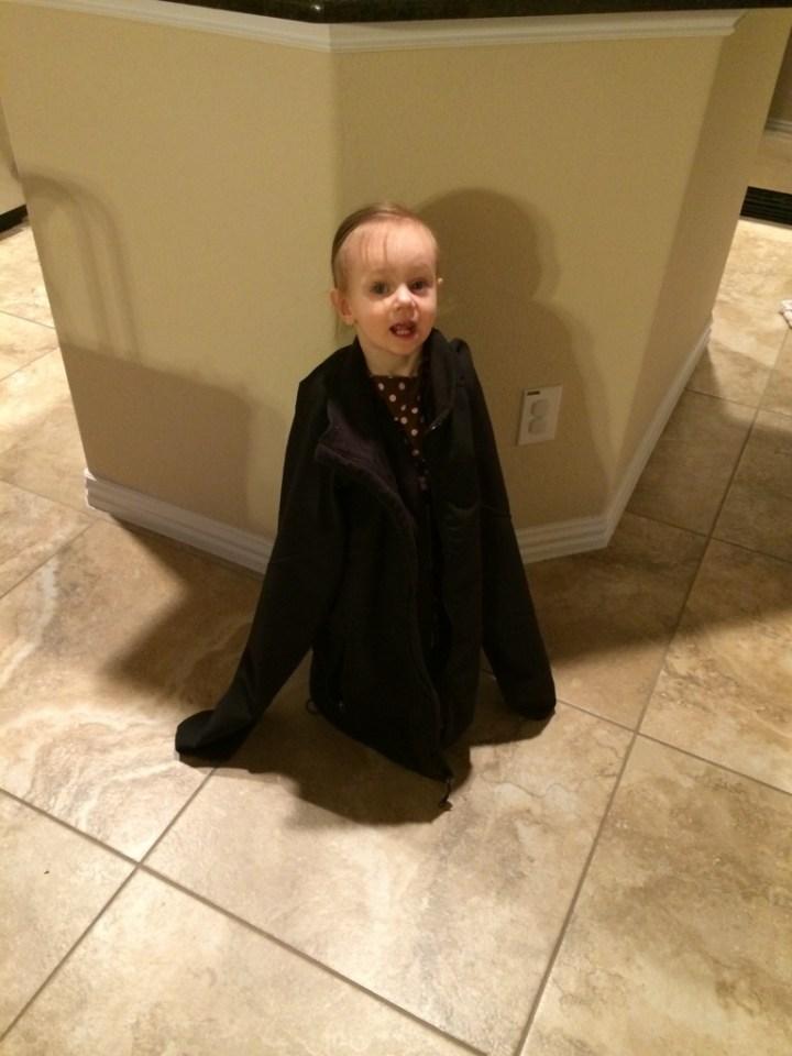Eliza wearing Adam's coat.