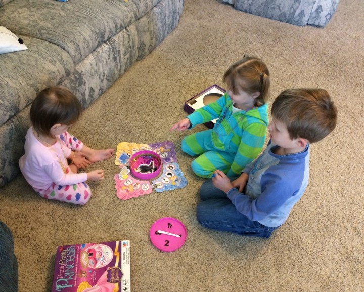 "Playing ""Pretty, Pretty Princess"" with her friends Lydia and Dean"