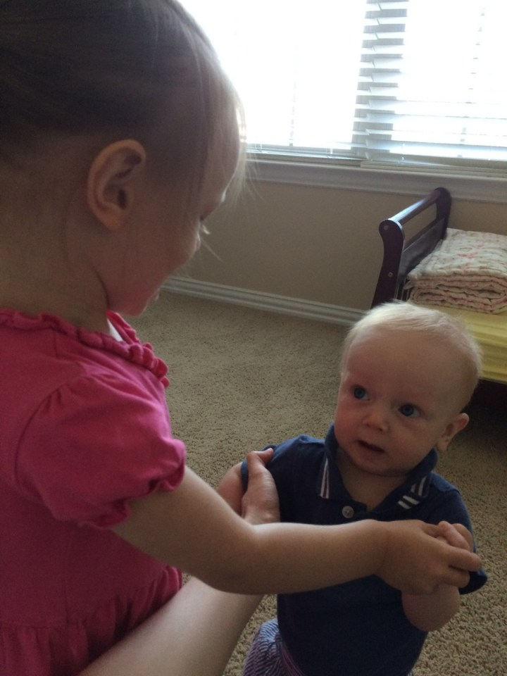 """Playing """"ring around the rosey."""" Eliza like the """"all fall down"""" part. James didn't like that part so much."""