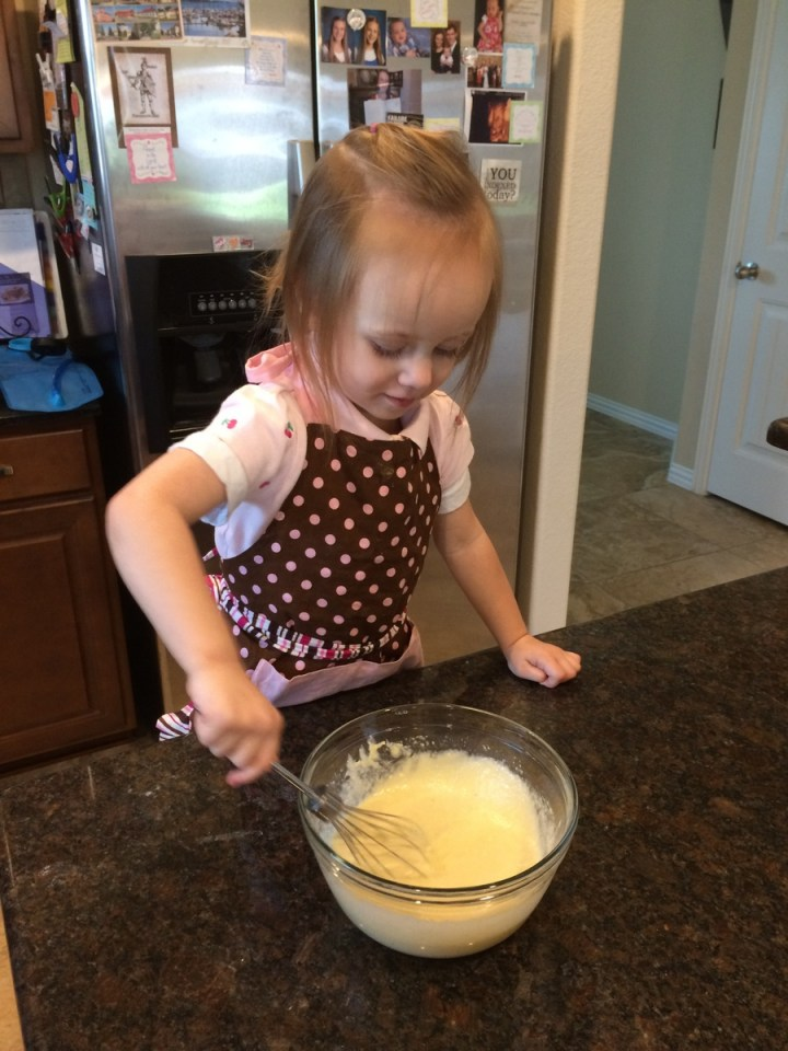 Eliza helping cook something