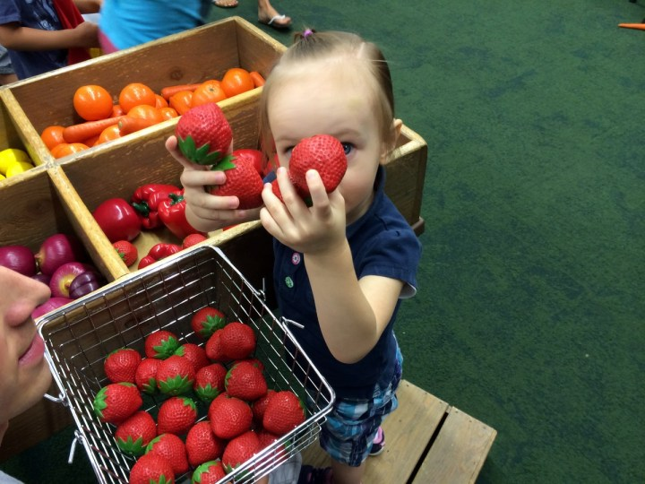 Eliza collecting the strawberries