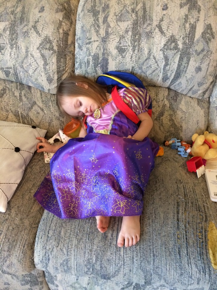 Sometimes you just need to fall asleep awkwardly on the couch with your princess dress and backpack on.