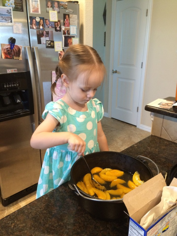 Eliza helping with the peach cobbler