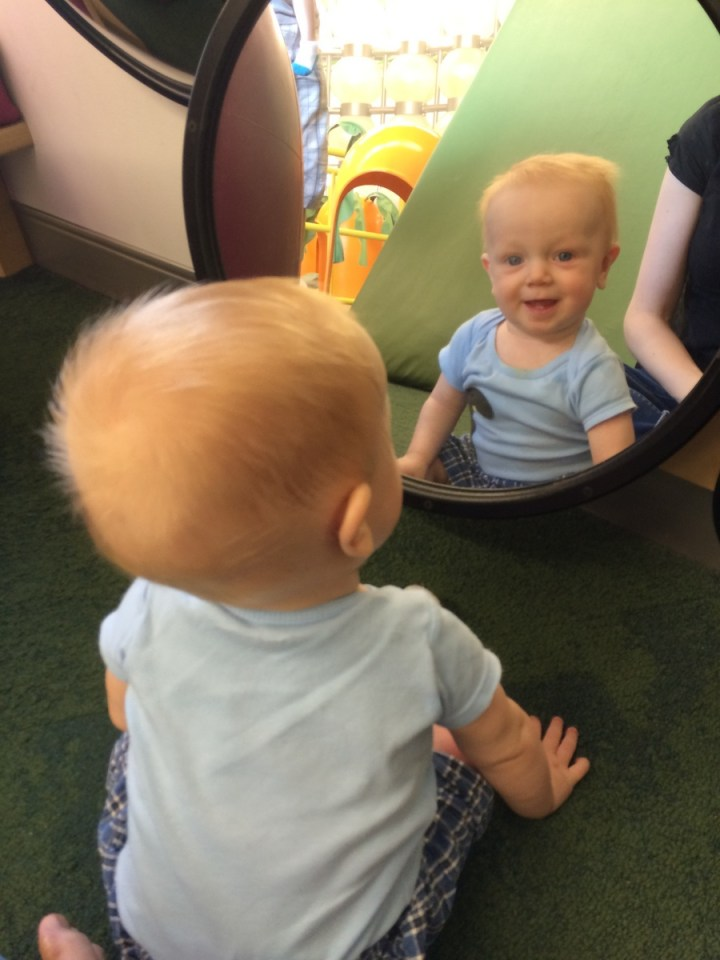 James smiling at mommy through the mirror.