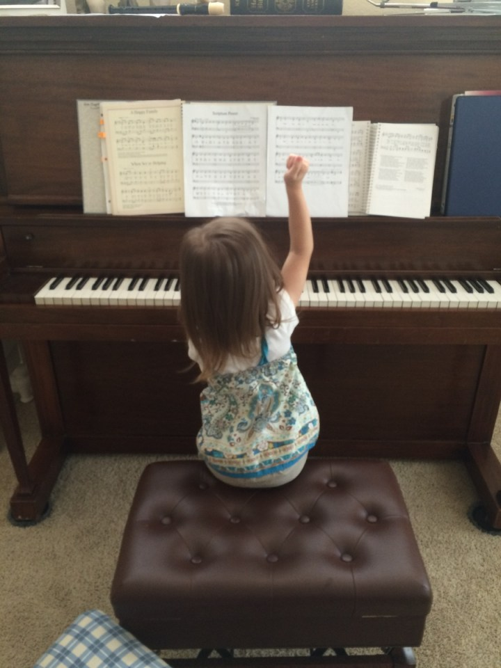 "Singing ""Scripture Power"" at the piano."