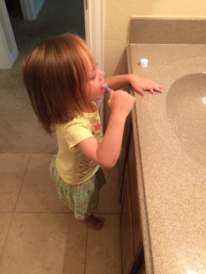 Eliza brushing her teeth