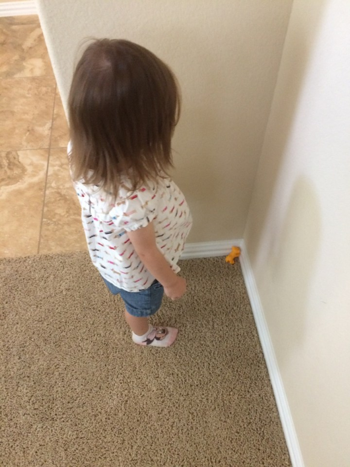 """Her little toy lion """"hit her"""" this week and so she put him in time out and made him say sorry."""