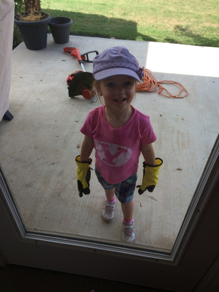 She always has to wear her gloves when she works with daddy in the yard.