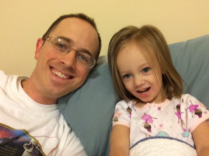 Eliza and Daddy hanging out while mommy is at the airport.