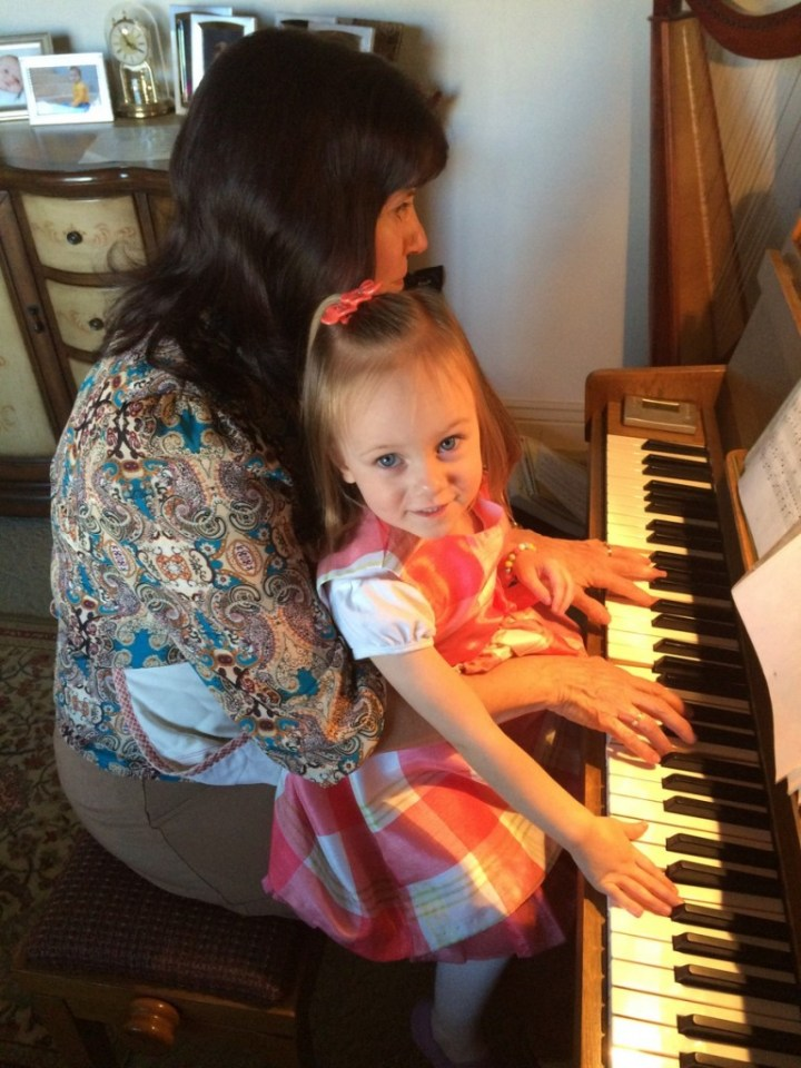 Eliza loved playing the piano with Grandma Huggard