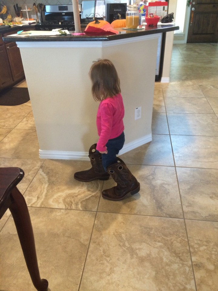 Eliza wearing daddy's boots.