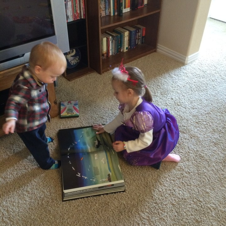 01 Eliza and James looking at daddy's space book