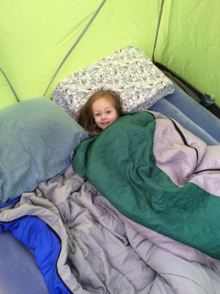 Eliza in daddy's sleeping bag.