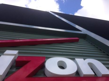 Giant Verizon sign on top of stadium