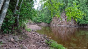 Superior Falls - Hiking along the rocky river shoreline towards the falls