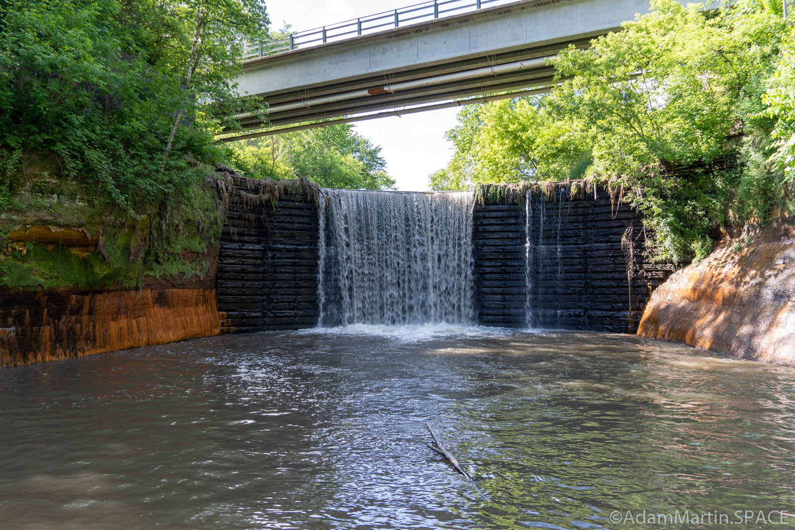 Douglas Mill Pond Spillway - View from below wading in Douglas Creek