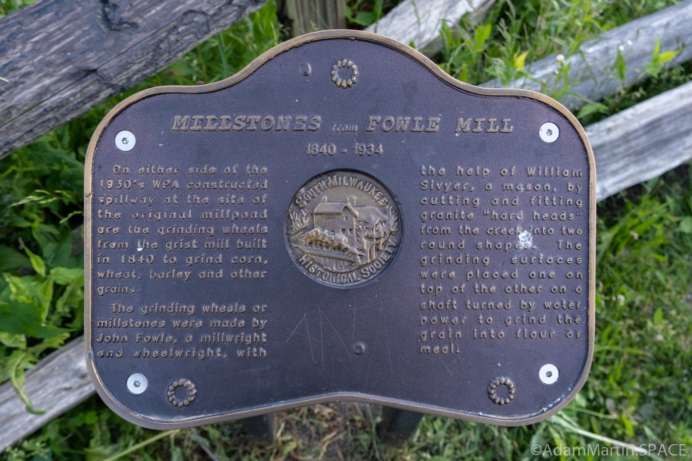 Millstones from Fowle Mill historical sign