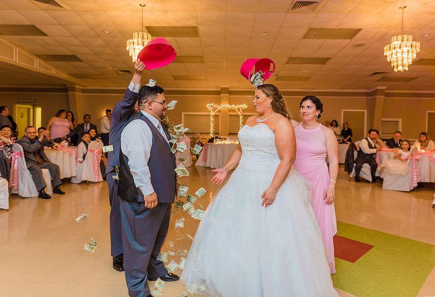 money dance at wedding by Washington DC Wedding Photographer Adam Mason
