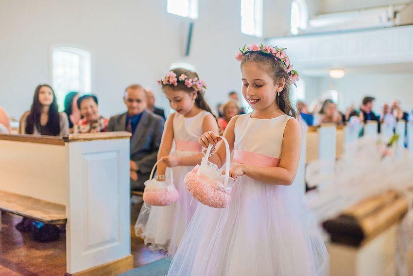 twin flower sisters at Hood College wedding by Washington DC Wedding Photographer Adam Mason