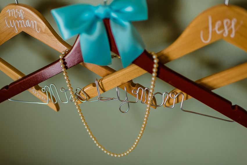 custom wedding hanger at Indian River Life Saving Station Wedding by Washington DC Wedding Photographer Adam Mason