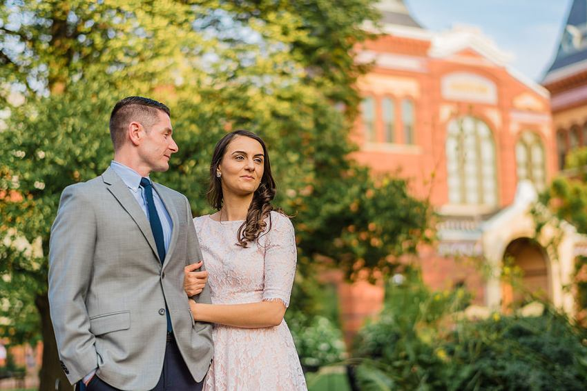 sunset engagement photos at the Smithsonian Castle in Washington DC by Washington DC Wedding Photographer Adam Mason