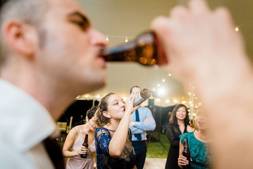 thunder acdc drinking game at fall wedding in virginia by Washington DC Wedding Photographer Adam Mason
