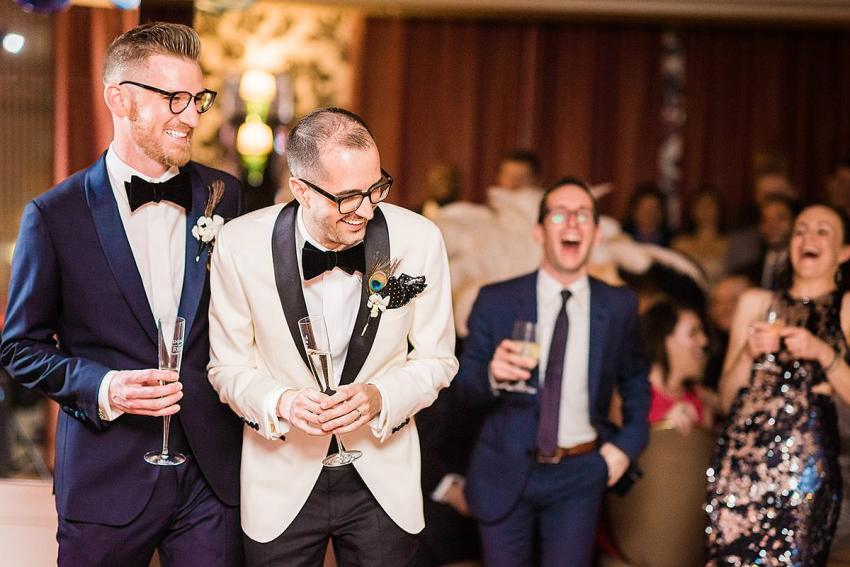 grooms laughing during speeches at hotel monaco wedding by Washington DC Wedding Photographer Adam Mason