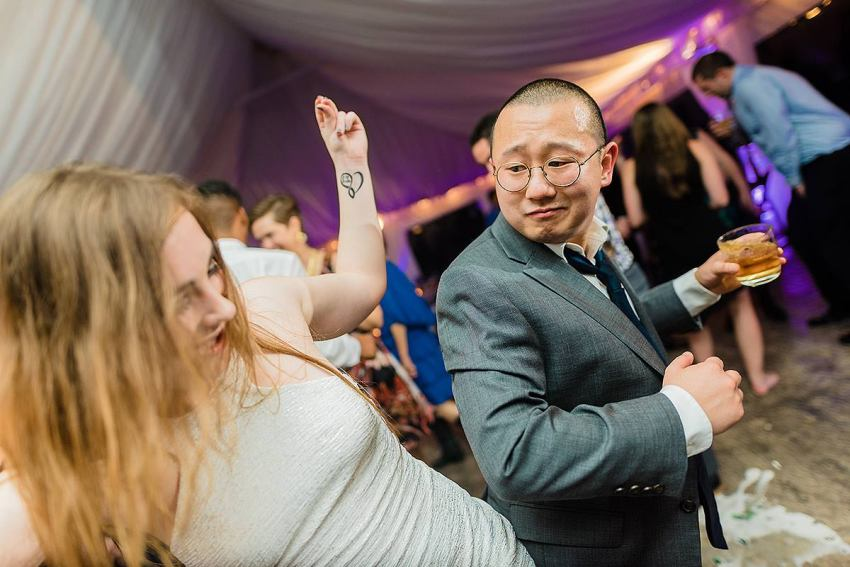 wedding guests dancing at irvine nature center wedding by Washington DC Wedding Photographer Adam Mason