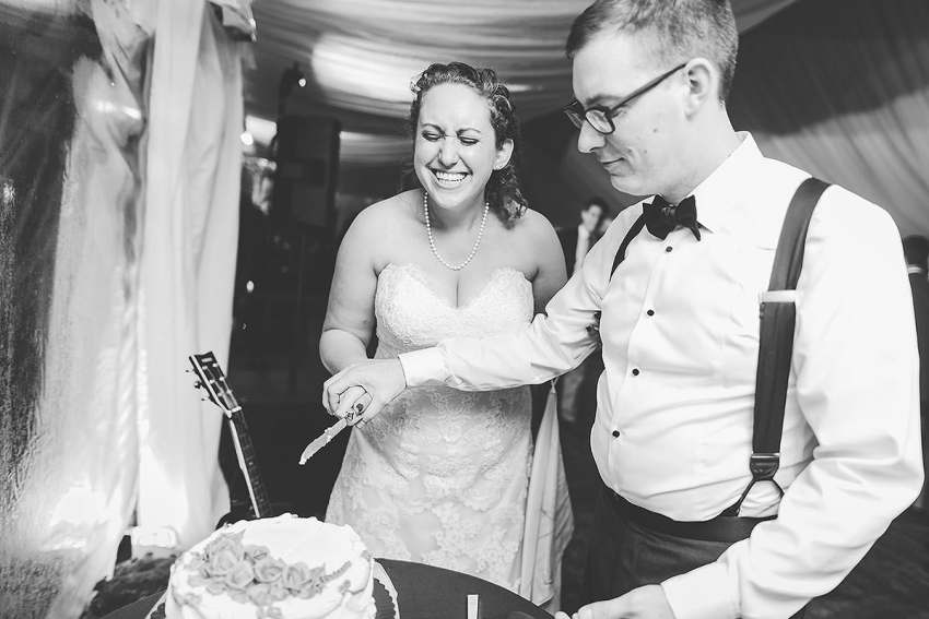 bride and groom cutting cake at irvine nature center wedding by Washington DC Wedding Photographer Adam Mason