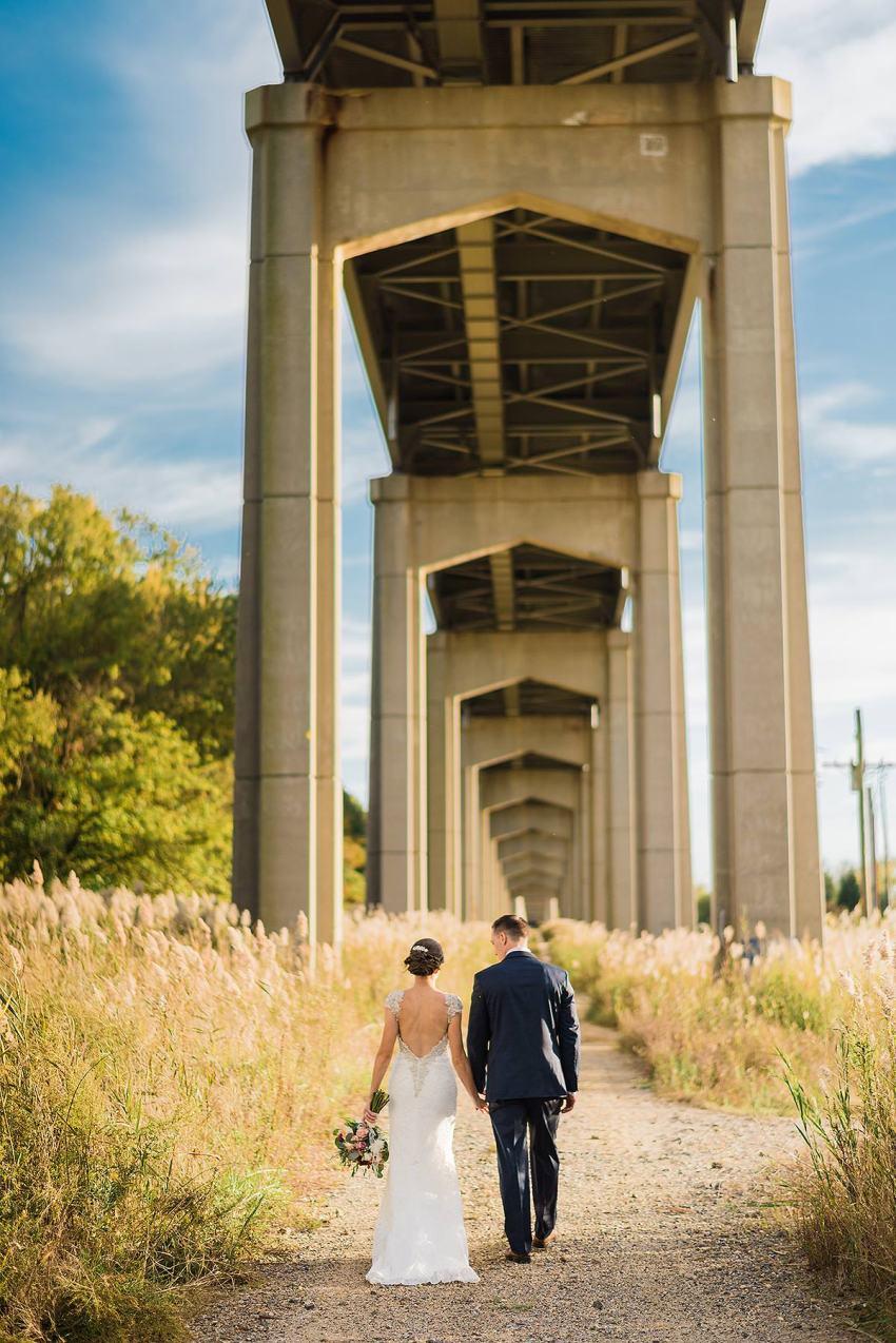 wedding portraits under delaware river bridge at thousand acre farm wedding by Washington DC Wedding Photographer Adam Mason
