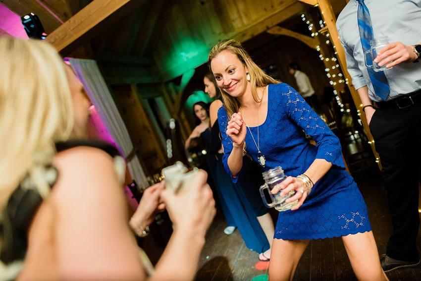 wedding guests dancing at at thousand acre farm wedding by Washington DC Wedding Photographer Adam Mason