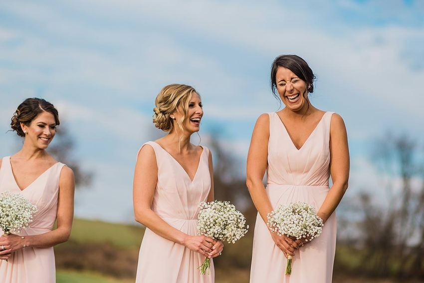 bridesmaids laughing outside at wyndridge farm wedding photos by Washington DC Wedding Photographer Adam Mason